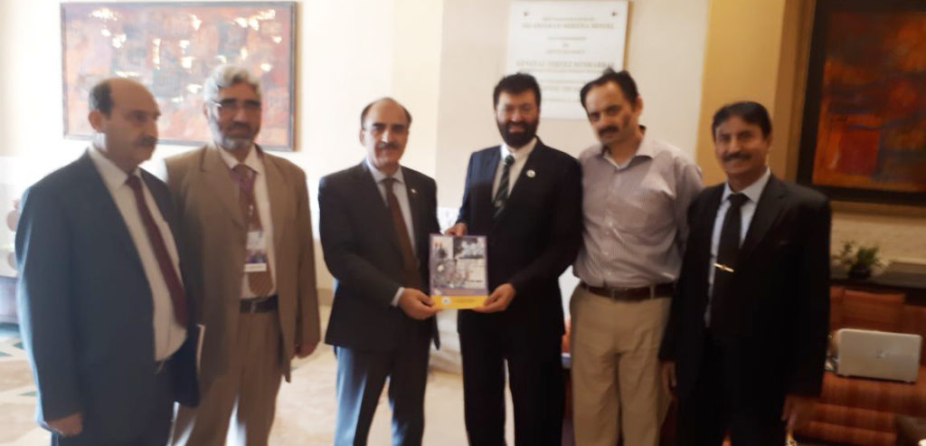 Dr. Attaullah Shah presented his book to Chairperson HEC
