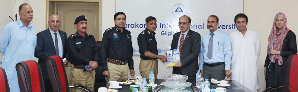 Vice-Chancellor-KIU-Prof.-Dr.-Attaullah-Shah-presenting-his-book-on-Eco-Engineering-to-IGP-GB